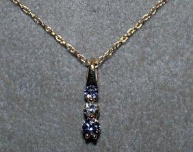 Beautiful 10kts Gold Pendant With Tanzanite & White