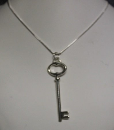 Stylish Sterling Silver Key Pendant with 20'' Chain.