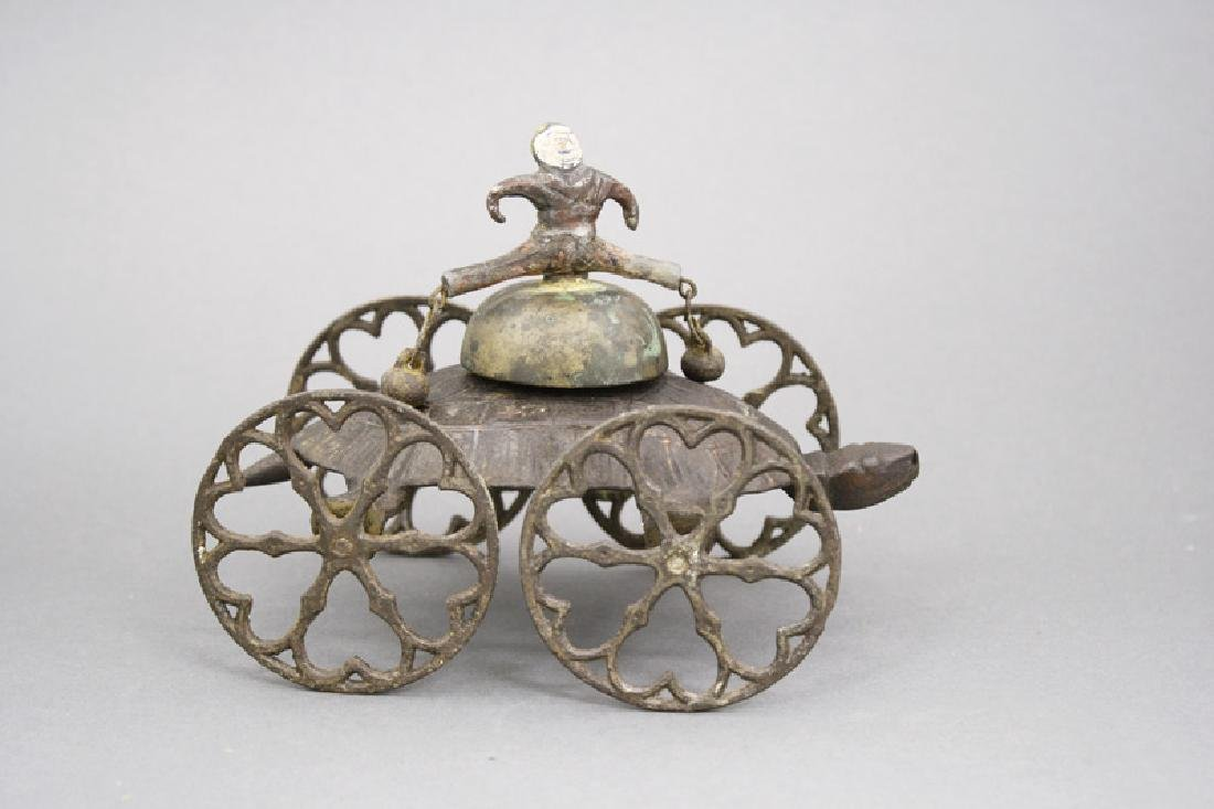 Boy Riding Turtle Bell Toy
