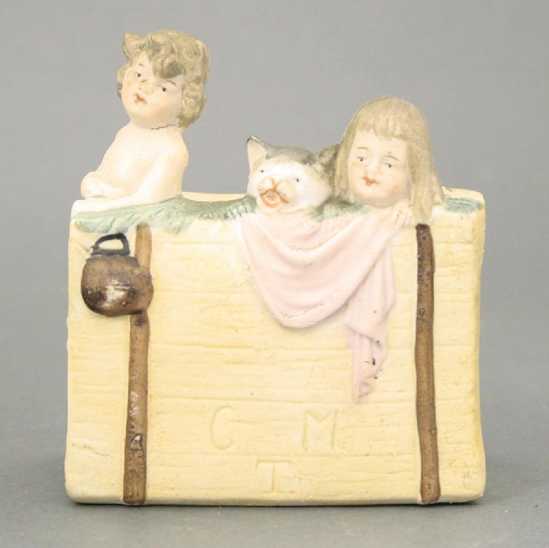Two Children and Cat in a Basket