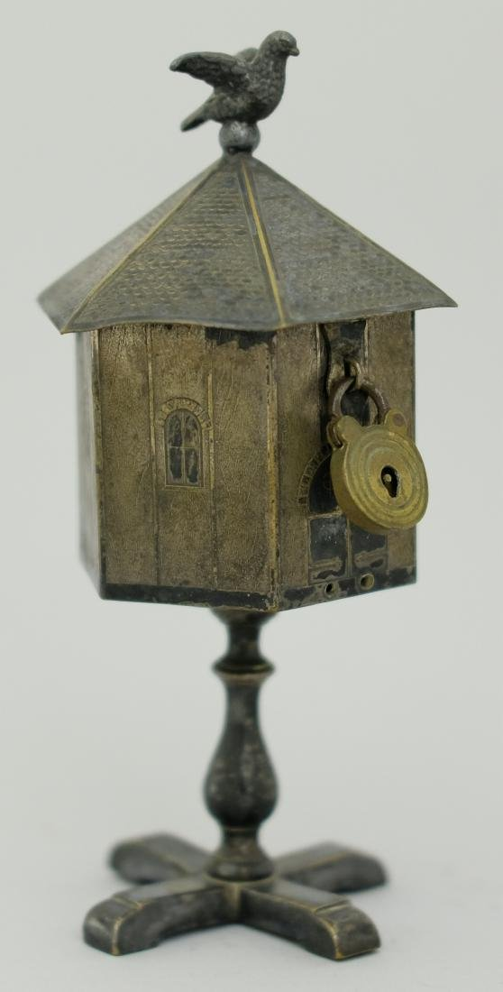 Bird atop Birdhouse
