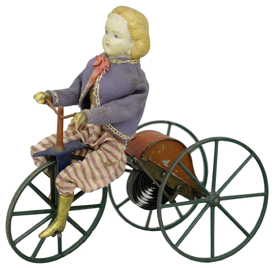 Blonde Boy Tricycle Rider Wearing Patriotic Costume
