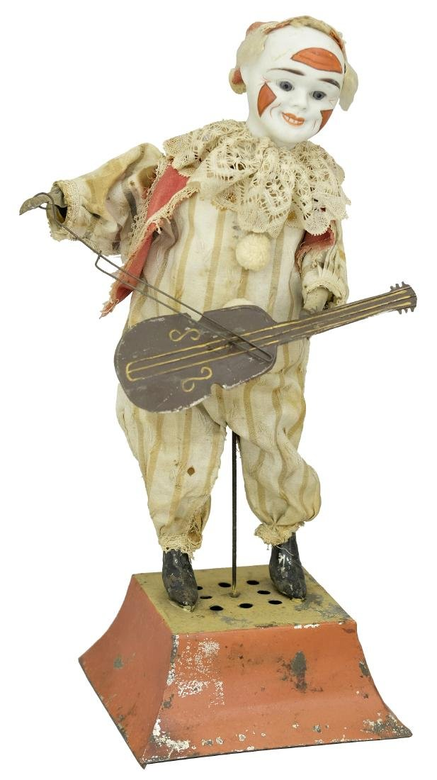 Large Clown Instrumentalist Figure with a Bisque Head
