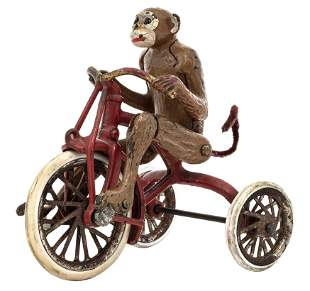 Monkey Riding a Tricycle Iron Toy