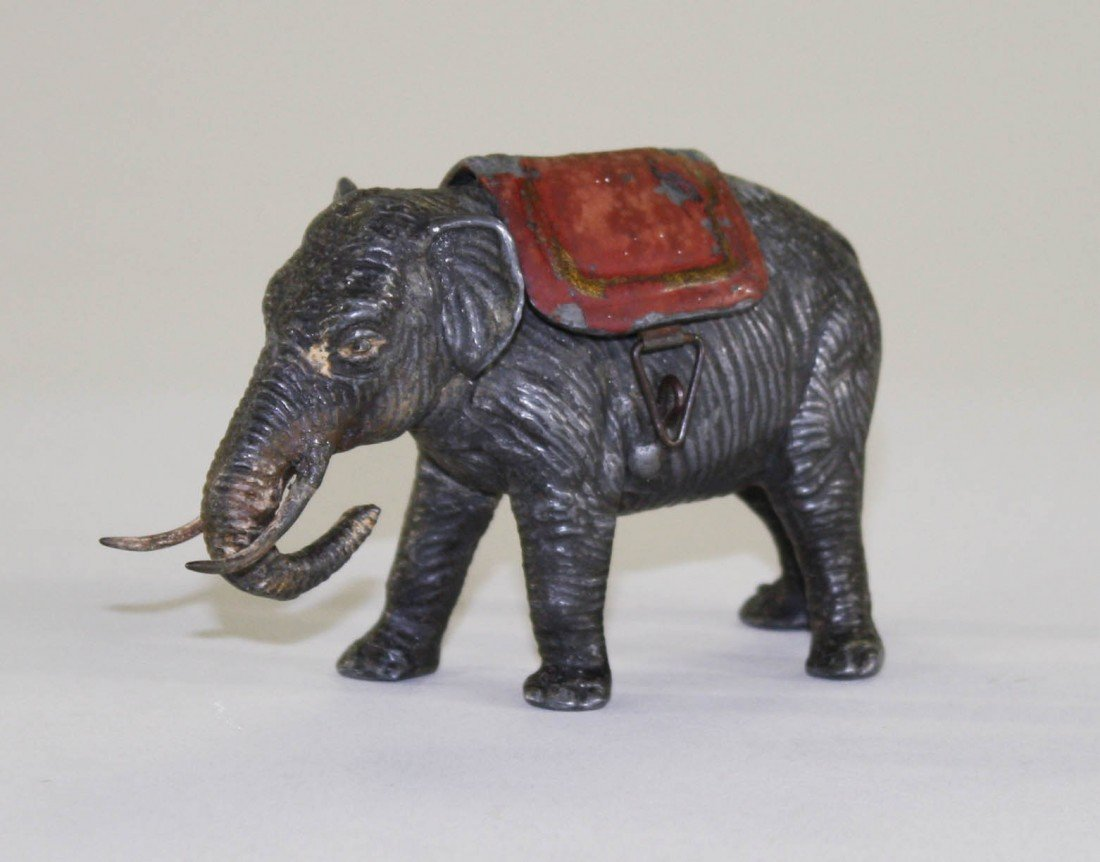 6: Walking Elephant with Red Blanket and Tusks Bank