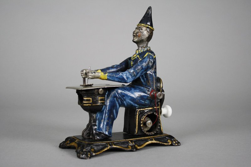 Clown Seated at Sewing Machine