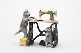 Two Cats At Sewing Machine