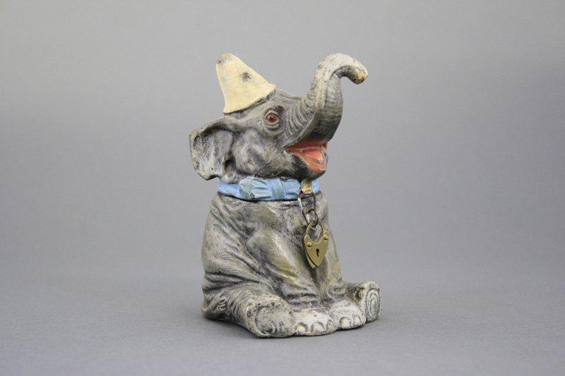 Seated Elephant Wearing Clown Hat