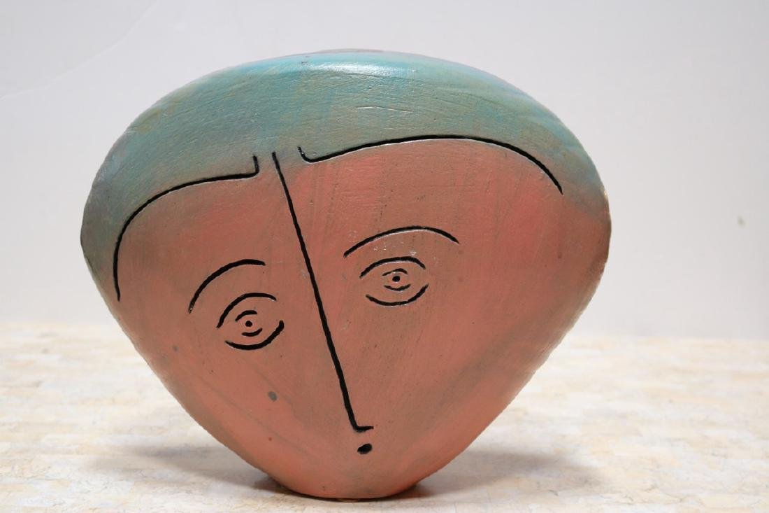 Ceramic Sculpture of a Head with Two Faces