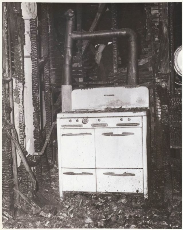 View of a kitchen stove that caught fire. C1958