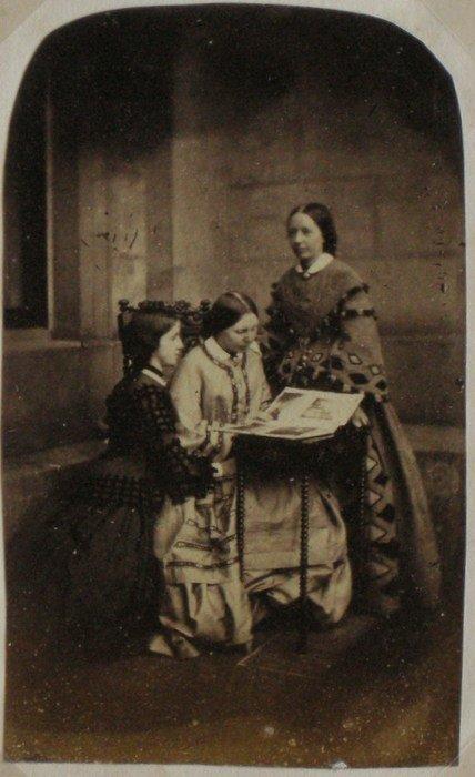 English Ladies viewing a Photograph Album. c1865