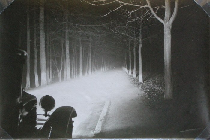 Rare photograph of a road lit by headlights. c1910