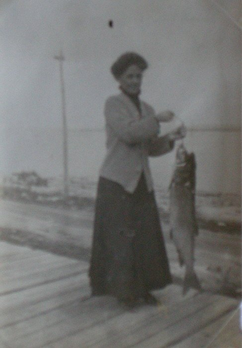 Lady caught a large fish. c1910