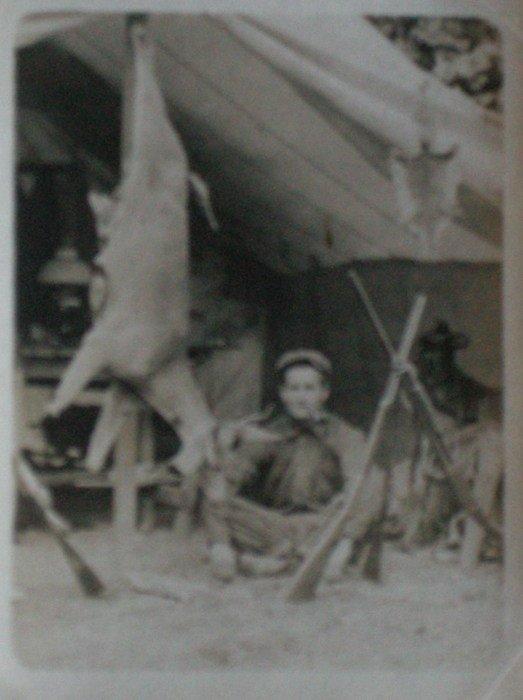Hunter and his kill. c1920