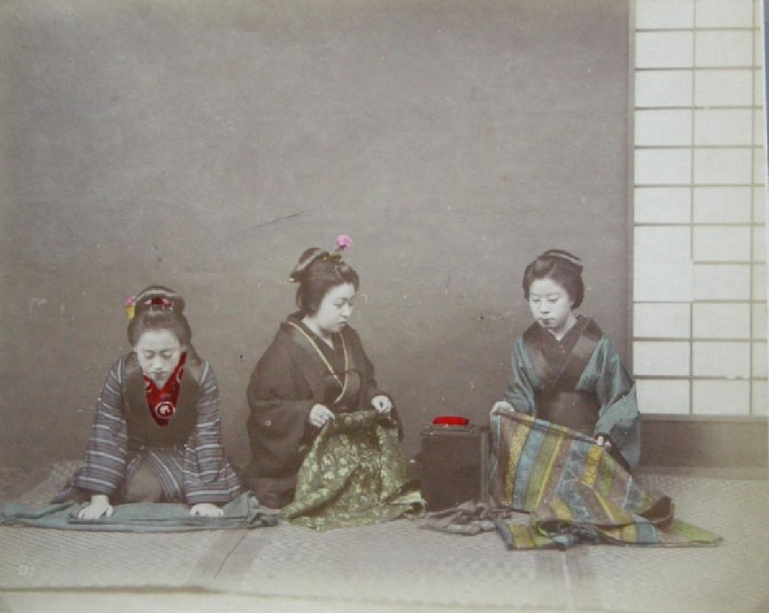 Japanese Girls  folding Obis. c1890