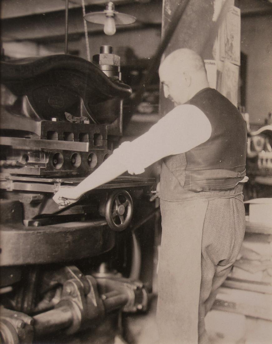 Man working heavy-duty Press. c1950