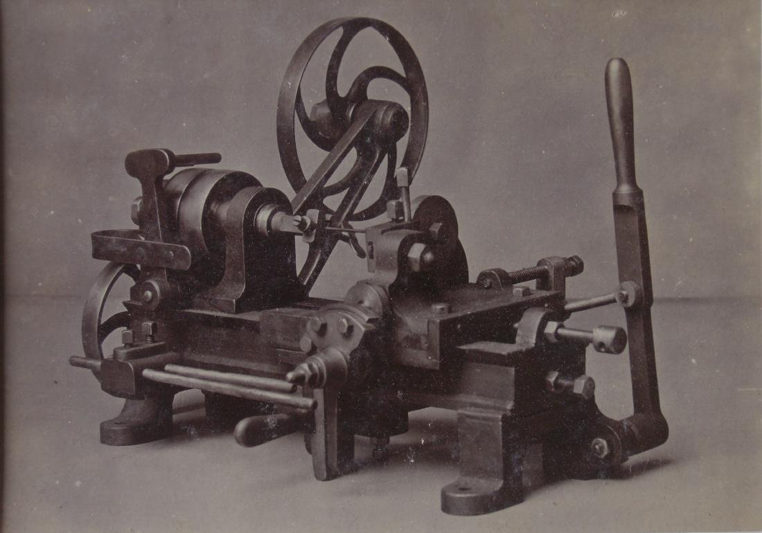 Cabinet card showing early machine. c1901