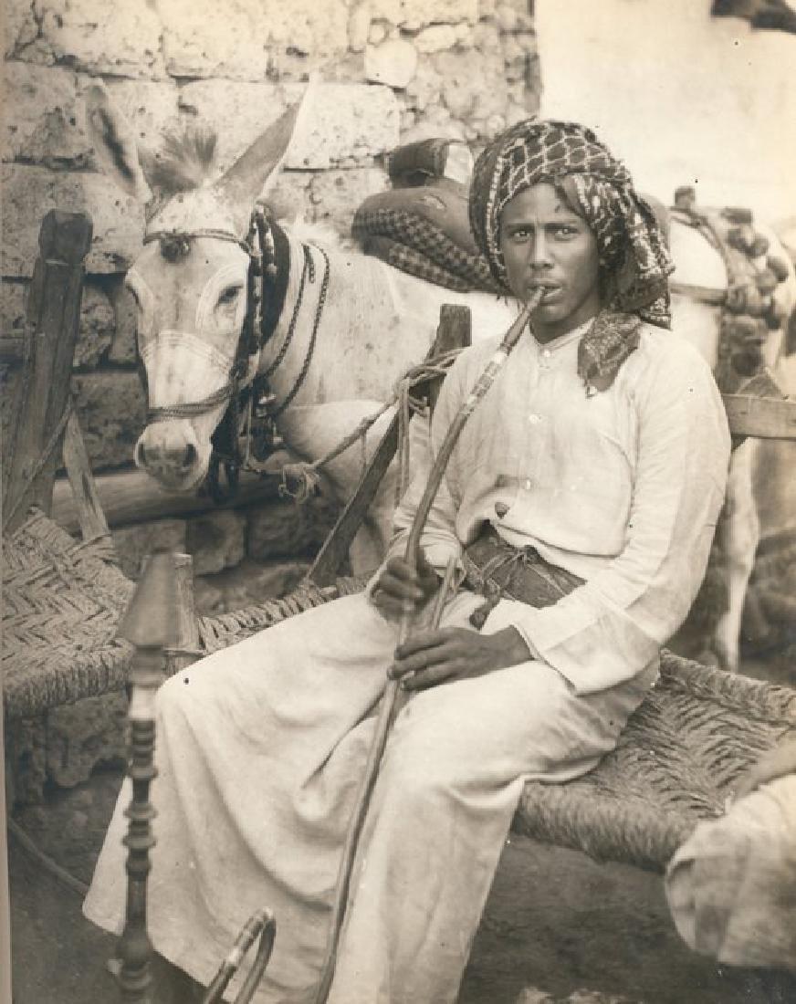 Mule Driver resting with his Hookah, Jidda. c1925