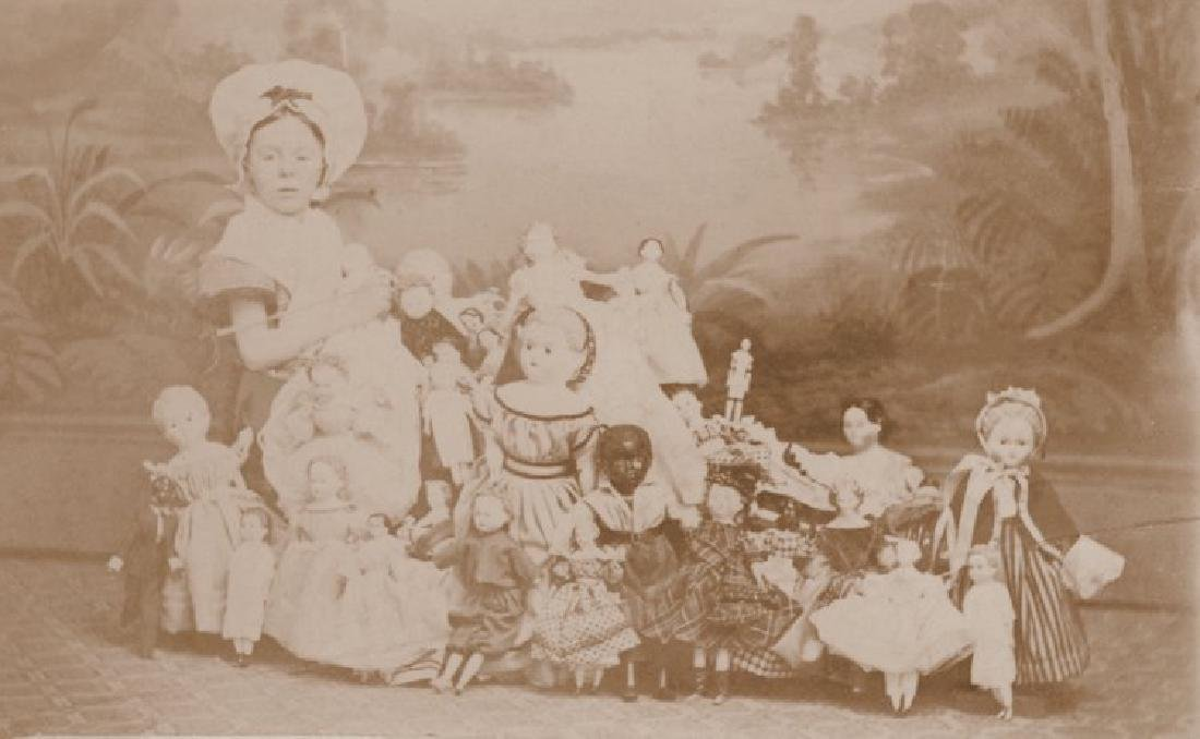 Young Girl with her 28 Dolls