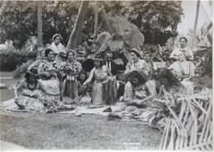 Hawaiian Ladies making grass skirts. C1930