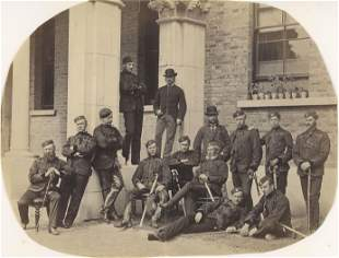 Irish Guards relaxing outside of their Mess. c1870