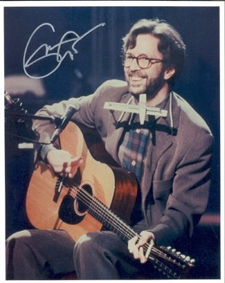 "764: Eric Clapton Signed ""Unplugged"" Photograph GAI"