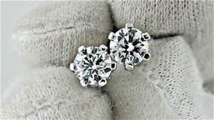 1.04 ct  round diamond stud earrings 14 kt white gold