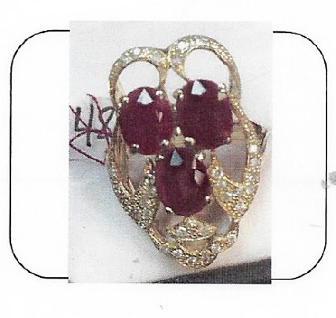 Lady's 10K yellow gold ruby/diamond ring