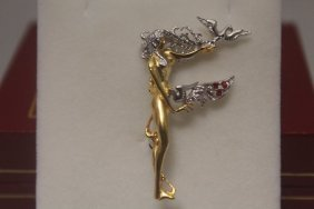 Elegant Gold Erte Pendant