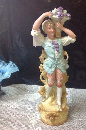 Germany Bisque Figurine Boy Holding Grape Basket