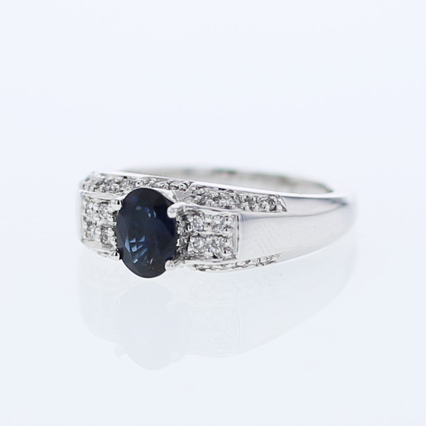Oval-shaped Sapphire w/ Pave-set Diamond Ring in 14K