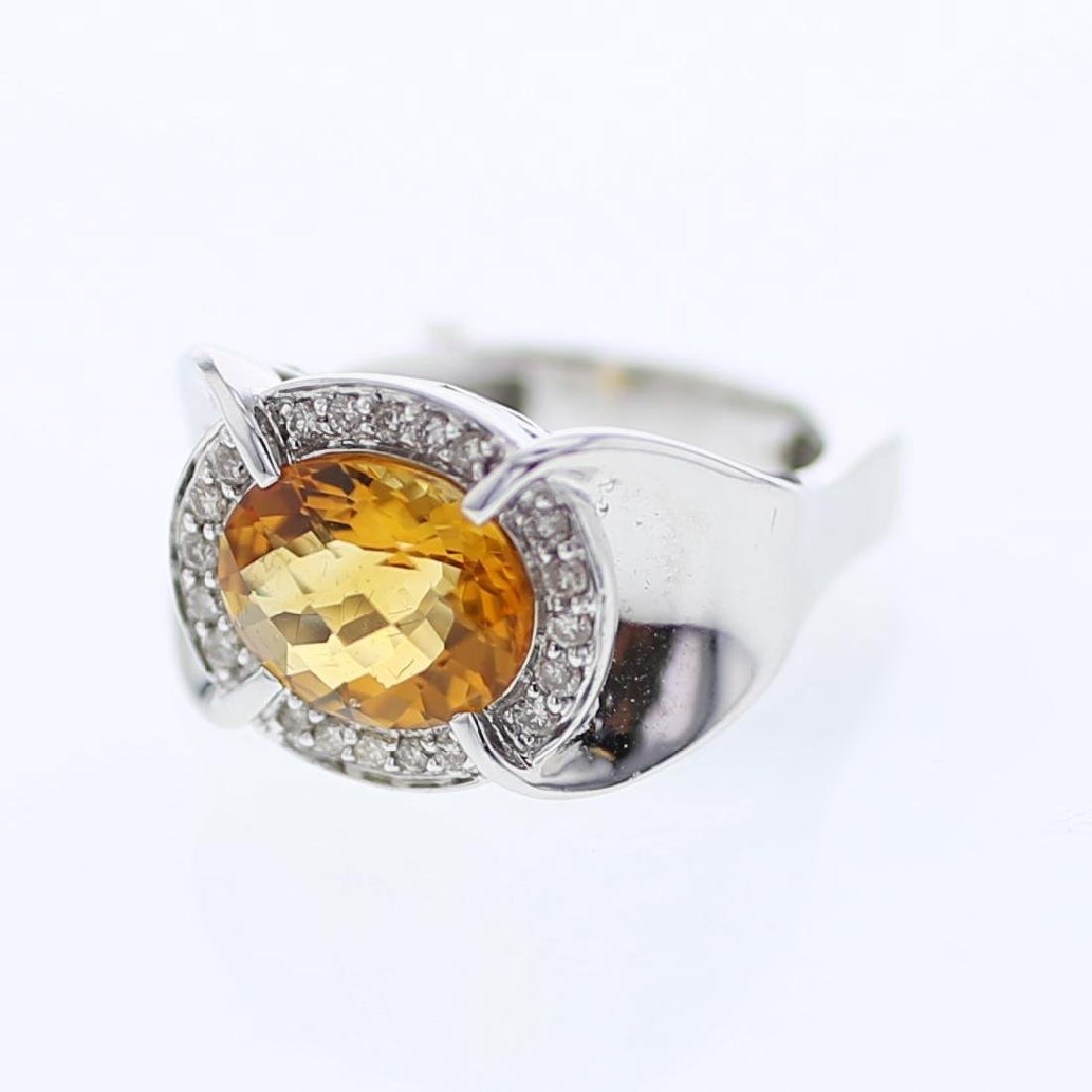 Oval shaped Citrine center sits in Halo Diamond Ring in
