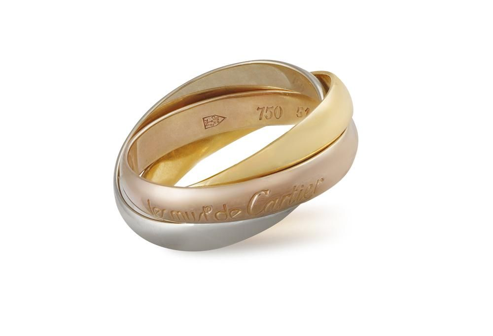 A 'TRINITY' RING, BY CARTIER Designed as three