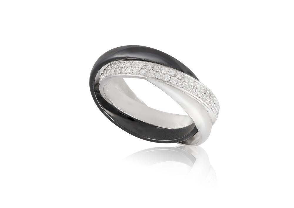 A DIAMOND 'TRINITY' RING, BY CARTIER Designed as three