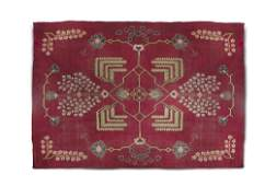 A LARGE ARTS AND CRAFTS RED GROUND WOOL CARPET,