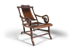 A CHINESE HARDWOOD RECLINING OPIUM CHAIR China, Qing