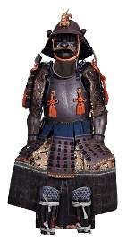 .A NATURAL AND LACQUERED WROUGHT IRON SAMURAI SUIT OF