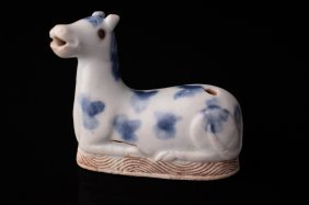 A Chinese Blue And White Porcelain Recumbent Horse