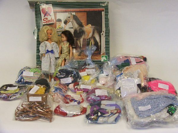 Sindy horse in original box, two Sindy dolls, and