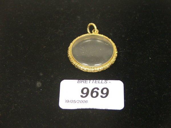 969: An Antique Circular Glass Locket, 9ct yellow gold,