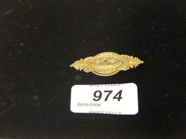 974: A 15ct Yellow Gold Antique Brooch inset with two d
