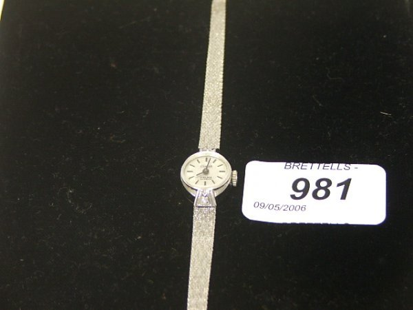 981: A Lady's 14ct White Gold Watch, the dial marked Co