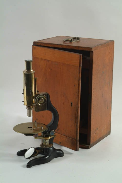 10: A Cased Iron and Brass Microscope stamped C. Baker,