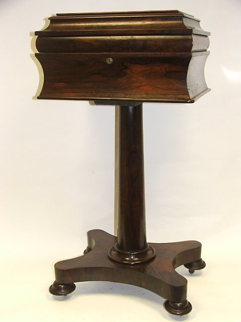 21: A Regency Rosewood Teapoy with rectangular lifting