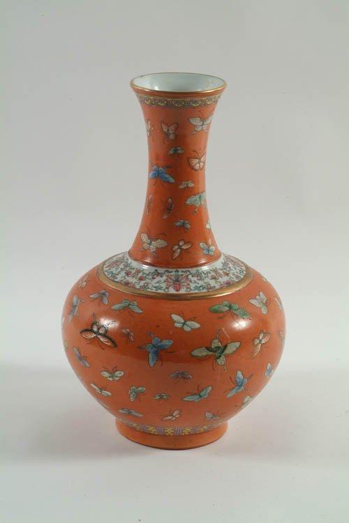 346: A Decorative Oriental Bottle Vase with butterflies