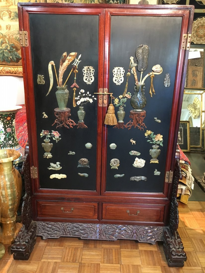 large Chinese display cabinet with jade covered doors
