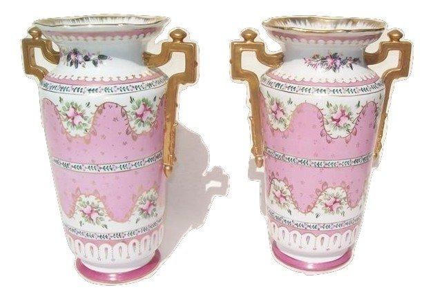 A pair of vintage Limogaes Porcelain urns