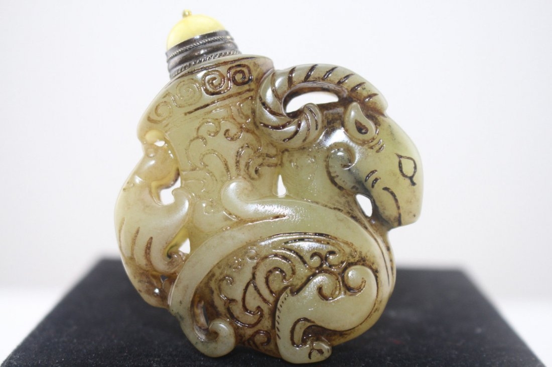 A hand carved Chinese Jade snuff bottle