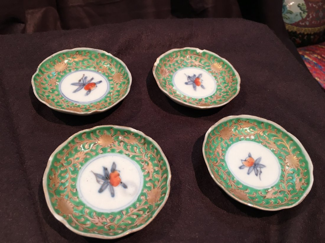 Set of Four Antique Famille Rose chinese saucers