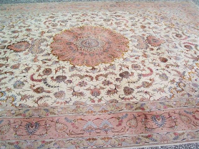 A fine Genuine Persian Tabriz rug 10 by 13